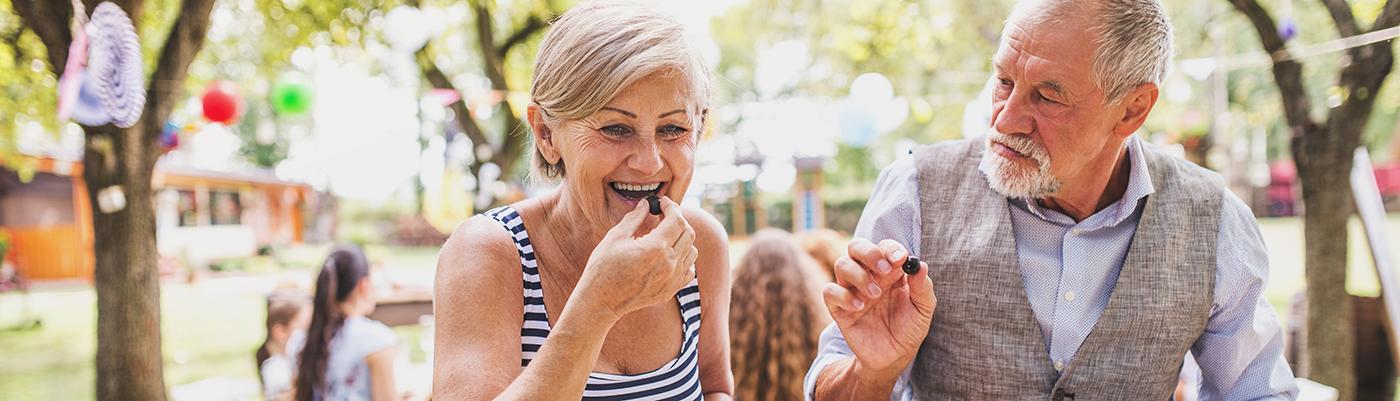 senior couple eating olives on patio
